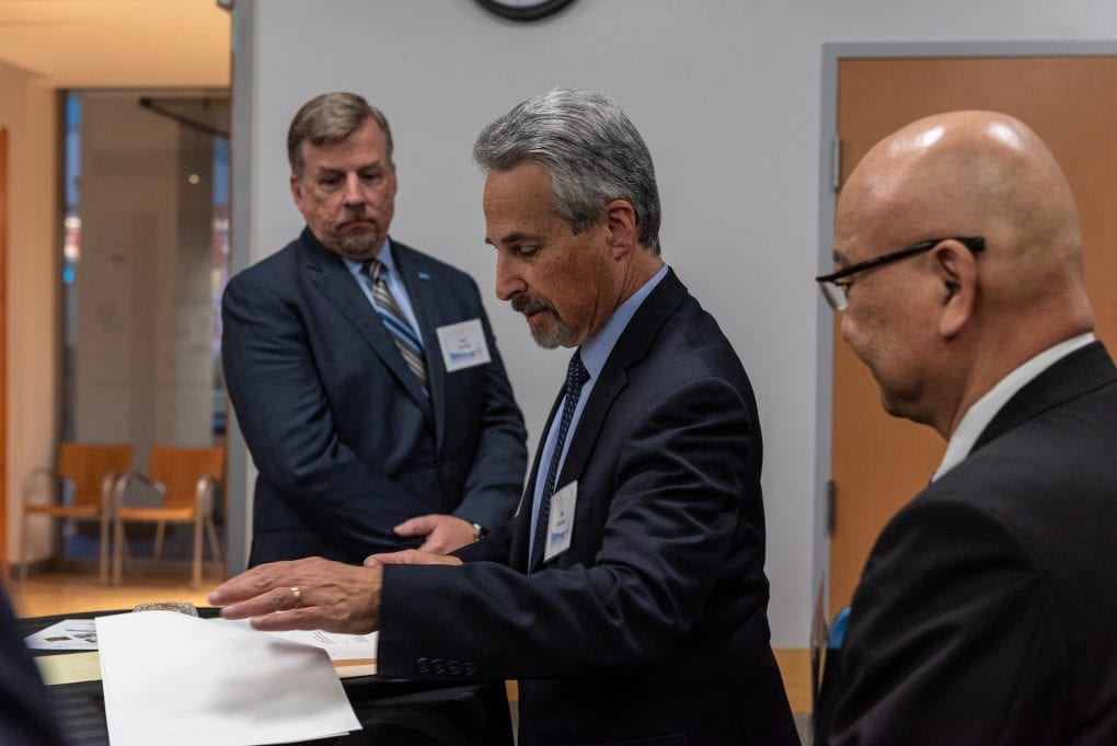 Lucas College and Graduate School of Business Dean Dan Moshavi, center, signs a gift agreement with Allied Telesis.