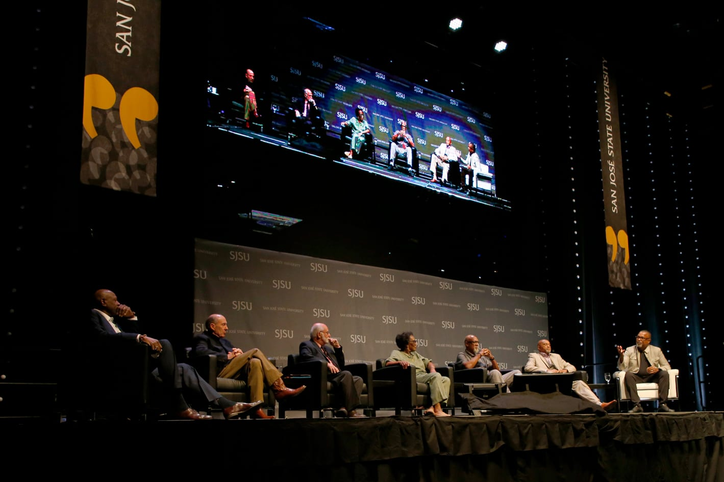 Panelists Spencer Haywood, Cleve Livingston, Paul Hoffman, Wyomia Tyus, John Carlos and Tommie Smith discuss athlete activism in the 1960s with Moderator Kenneth Shropshire. Photo: Josie Lepe