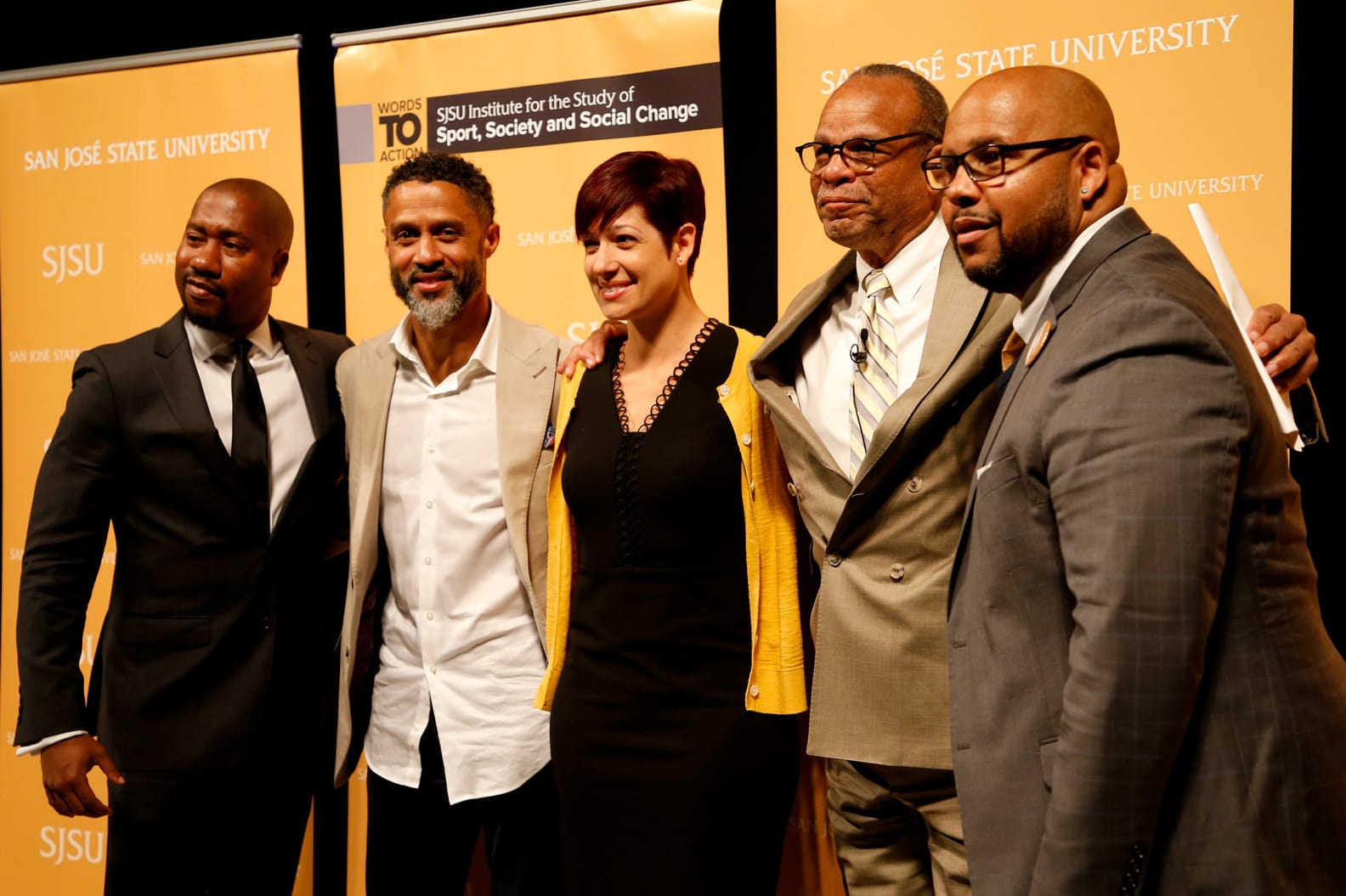 Bridging the Gap: Perspectives on Athlete Activism in an Era of Growth Panelists Damion Thomas, Mahmoud Abdul-Rauf, Toni Smith-Thompson, and C. Keith Harrison (right) pose with Moderator Bill Rhoden, (second from the right.)
