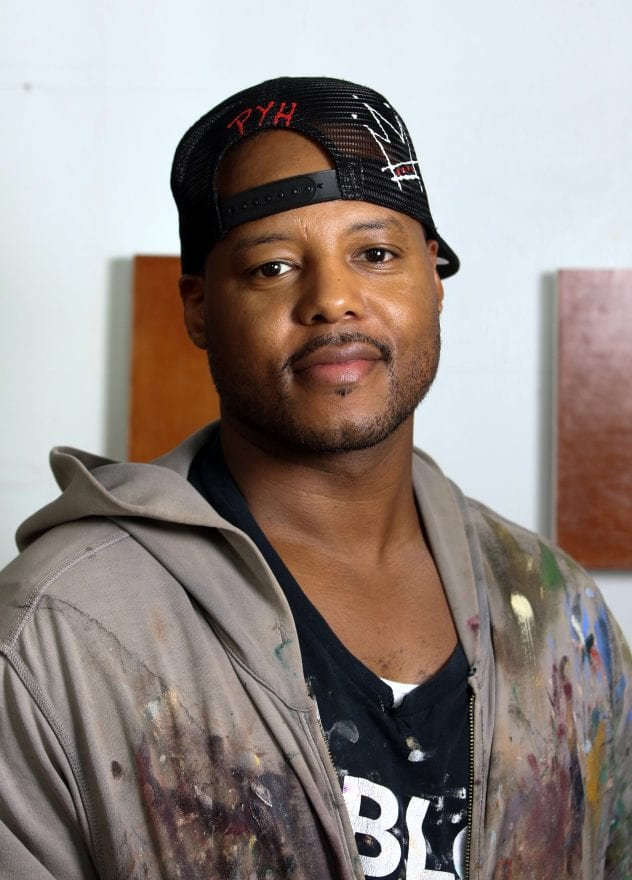 Titus Kaphar, '01 B.F.A., is a painter and sculptor who addresses the lack of representation of people of color in the history of Western art by appropriating Western art's styles and mediums. Here he is pictured in his studio in New haven, CT. (Photo by John D. and Catherine T. MacArthur Foundation)