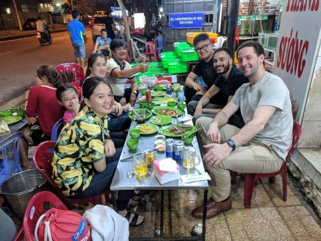 Prof Leineweber, far right, enjoys a meal in Nha Trang, Vietnam with SJSU student Hoang Nguyen and Nguyen's family.