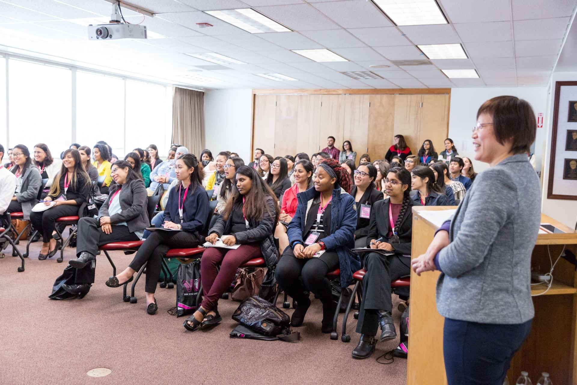 University and community college students listen to women leaders from top technology firms during the Silicon Valley Women in Engineering Conference in 2018. Photo by David Schmitz