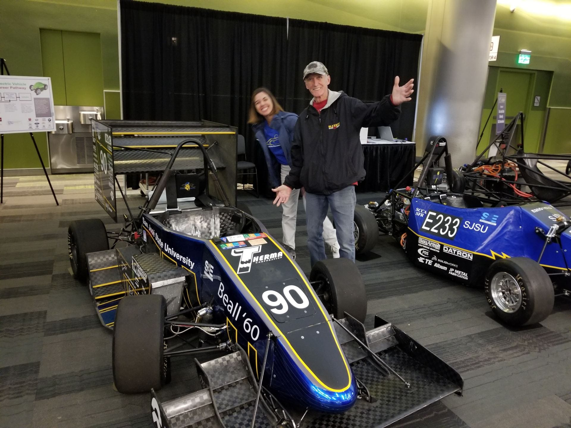 Visitors to the Silicon Valley Auto Show look at SJSU Formula SAE racing cars. Photo courtesy of the Charles W. Davidson College of Engineering.