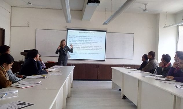Claire Komives, in the center by the screen, offers training on using active learning techniques at the end of her last Fulbright Scholar year in 2014-15.