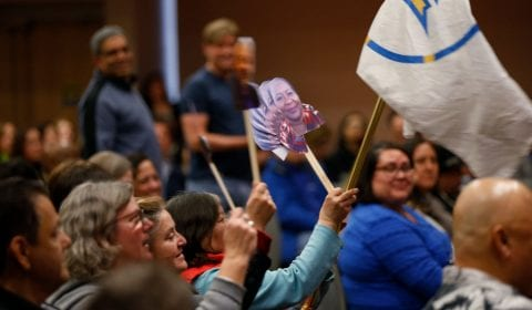 Colleagues cheer and wave paper cut outs of the honorees glued to wooden sticks during the Spartan Service Celebration ( Josie Lepe/San Jose State University )