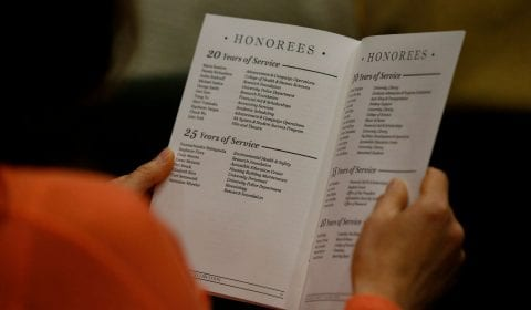 A guest looks through the program at the list of honorees. ( Josie Lepe/San Jose State University )