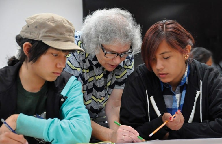 Professor Tatiana Shubin, center, works with students.