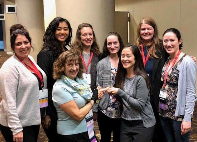 Department chair Wynn Schultz-Krohn and OT students pose with their first-place award for raising the most money of any other student group in the St. Catherine's Challenge.