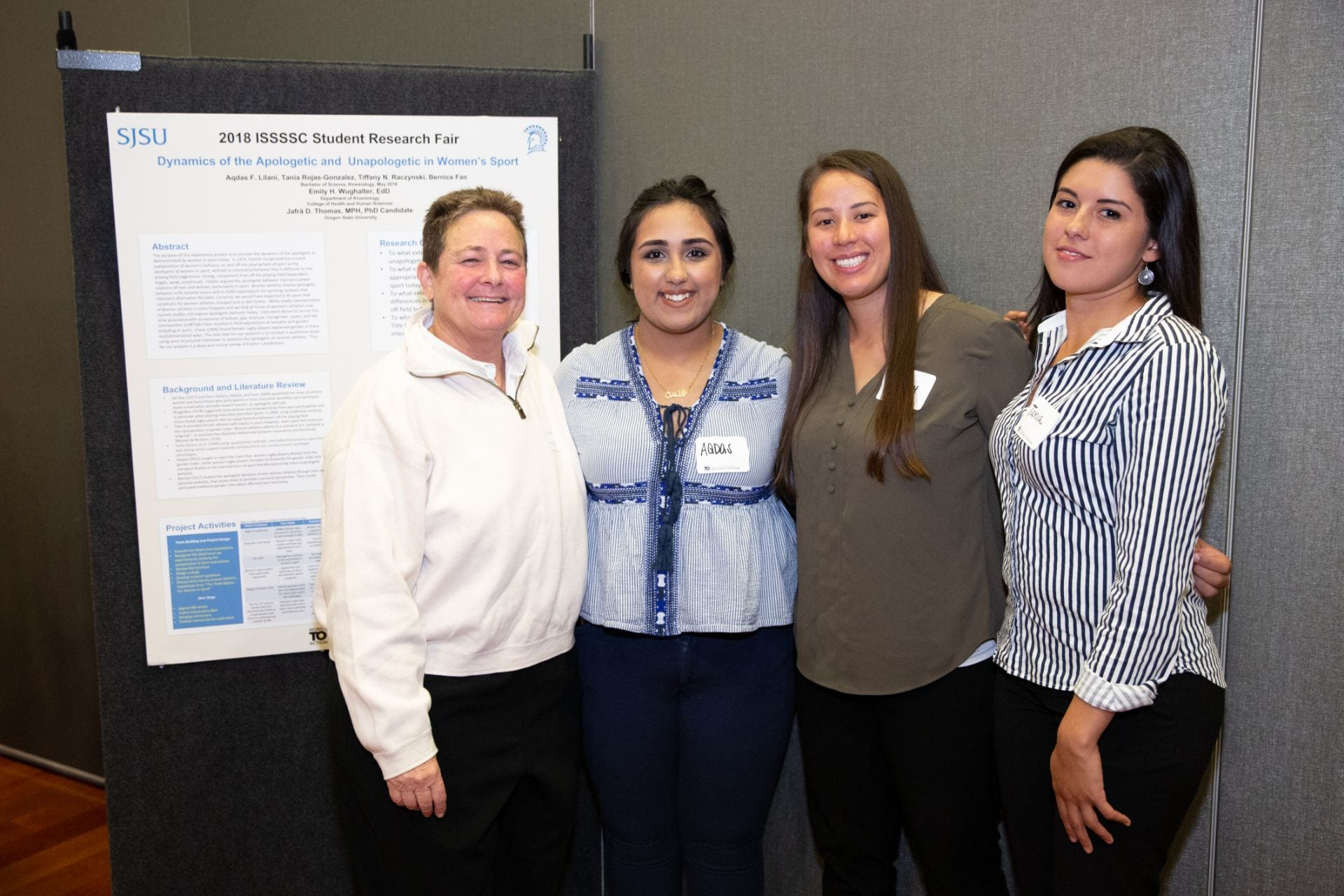 Professor Emily Wughalter, Aqdas Lilani, Tiffany Raczynski and Tania Rojas pose for a photo at the Institute for the Study of Sport, Society and Social Change Student Research Fair in 2018. Photo by David Schmitz