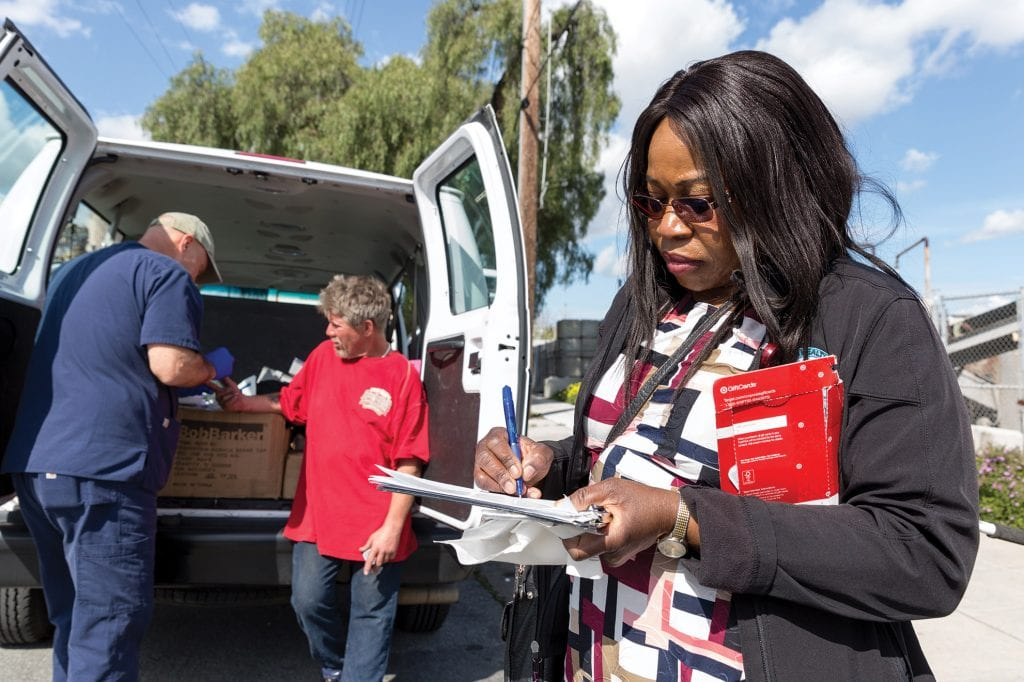 SJSU is accepting applicants for its solo doctor of nursing practice program to start this fall. Here, 2014 DNP graduate Mercy Egbujor works with patients in the field.