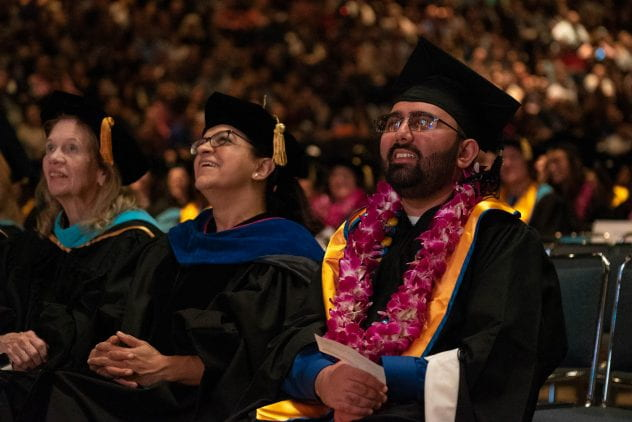 Devdutt Srivastava listens to speakers during the Connie L. Lurie College of Education commencement ceremony. Photo by Brandon Chew