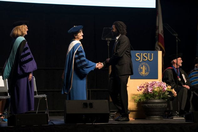 President Mary A. Papazian shakes hands with a President Scholar at Honors Convocation on May 3. Photo by Brandon Chew