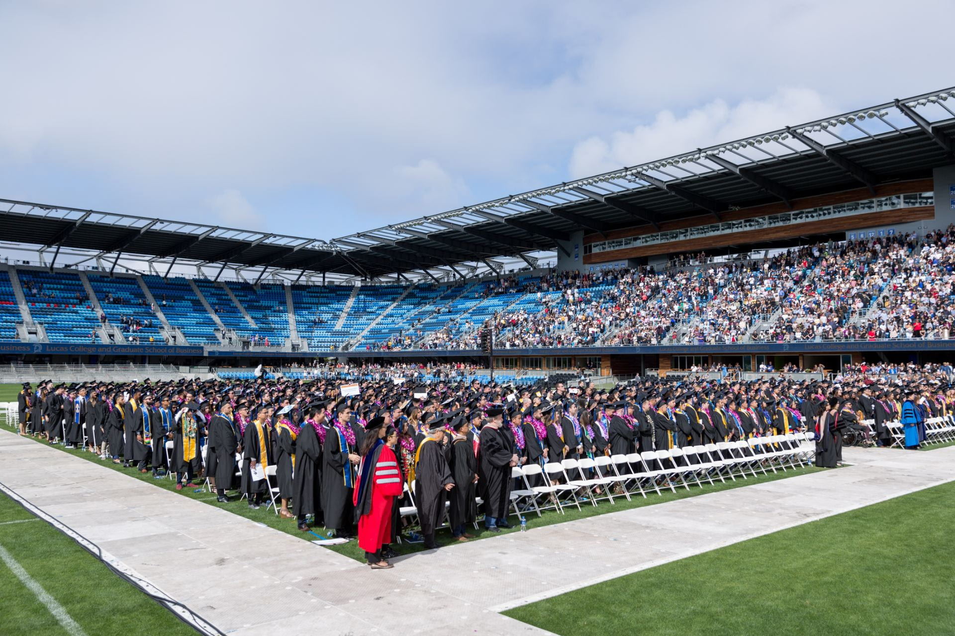 Graduates of the class of 2018 file into Avaya Stadium for commencement. Photo by David Schmitz
