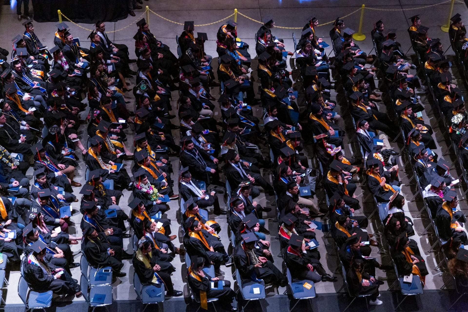 Students don their caps and gown during fall commencement in December 2018. Photo by David Schmitz