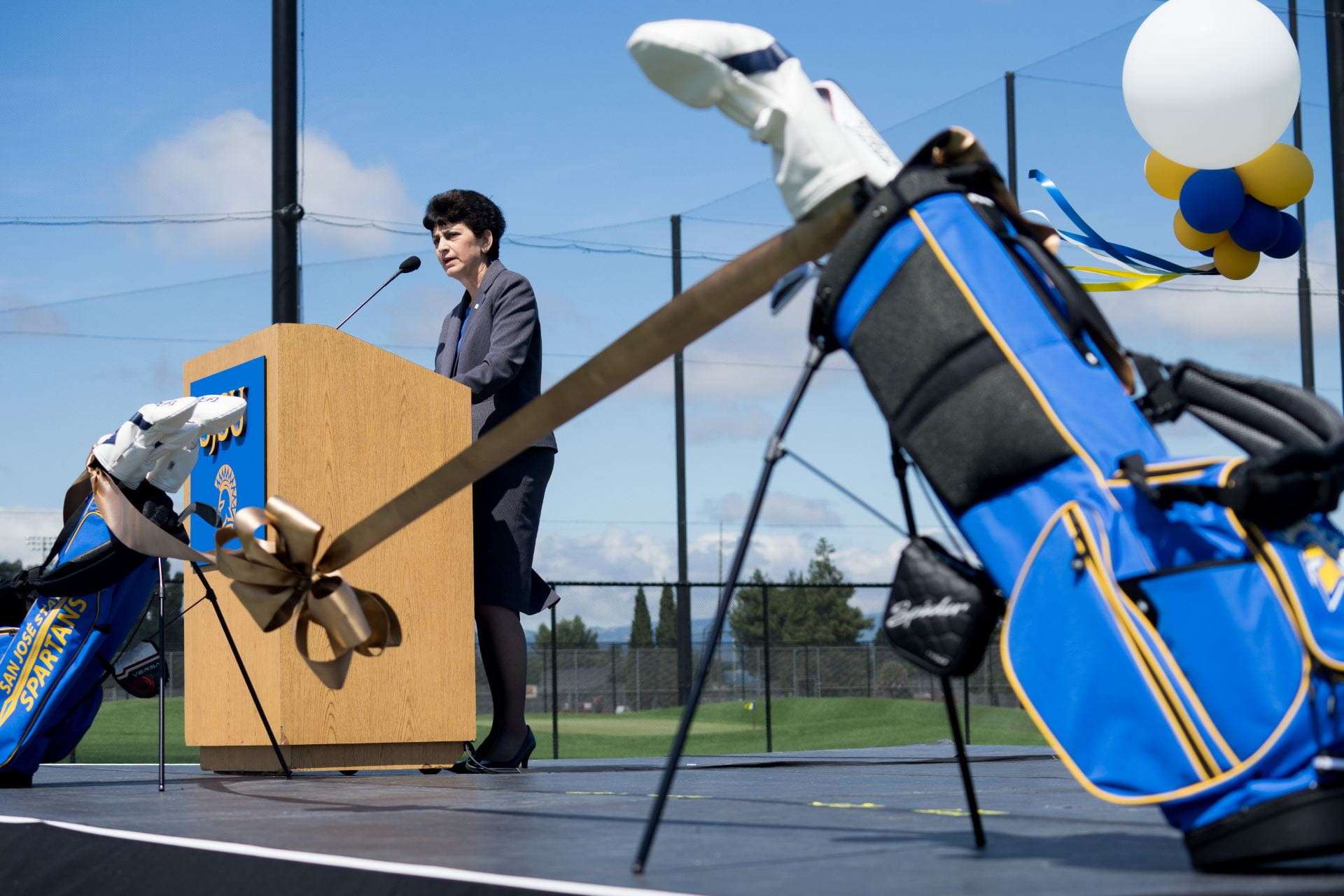 SJSU President Mary Papazian addresses attendees of the Spartan Golf Complex ribbon cutting June 1, 2017, at South Campus. (James Tensuan/SJSU)