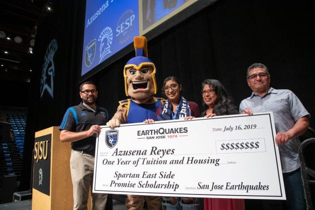 Azusena Reyes, photographed with her parents (on the right), is presented the East Side Promise Scholarship by San Jose Earthquakes representatives during freshman orientation at San Jose State University on Tuesday, July 16, 2019. (Photo: Jim Gensheimer)