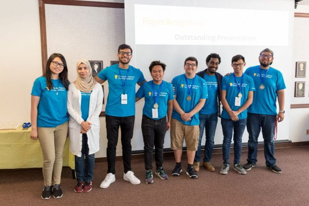 Ray Sawyer, third from the right, poses with students during the final day of Google's CSSI Extension program. Photo by David Schmitz