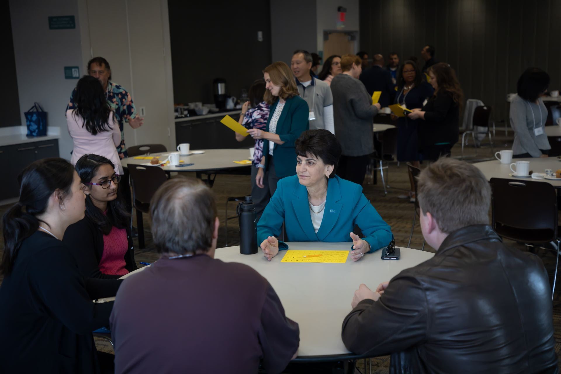 "President Papazian talks with staff members at a ""Coffee with the President"" event."