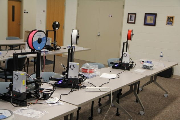 Multiple 3D printers assembled by students with visual impairment.