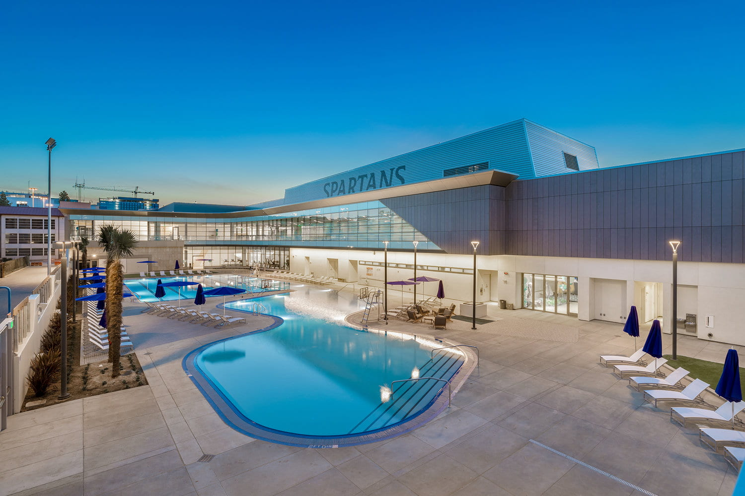Night shot of the SRAC pool and exterior building.