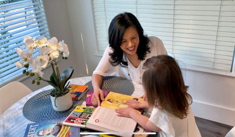 Lisa Millora and daughter reading together