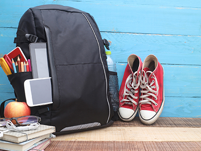 Teen backpack with sneakers and apple