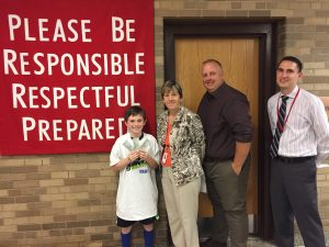 From left: SOMS Week 6 Upstander Alex P., teacher Ms. Kerry Beckmann, Dean Mr. Michael Ryan and Assistant Principal Dr. Chad Corey.