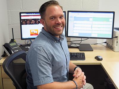 CLE Assistant Principal Robert Schliessman seated at desk