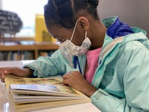 Girl reading graphic novel