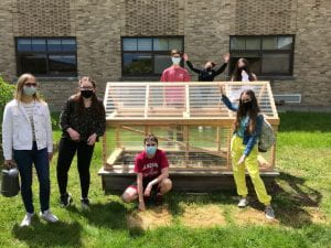 Students with micro greenhouse at SOMS