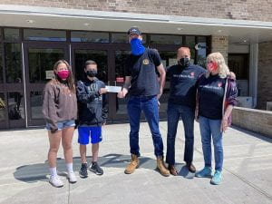 NJHS officers hand donation to Nyack Homeless Project representatives