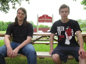 TZHS seniors and Eagle Scouts Corbin (left) and Ryan (eight) seated outside TZHS on a picnic bench