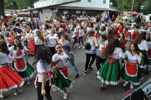 A crowd dances the Tarantella, led by TZHS and SOMS students, at the 2017 Italian Fest