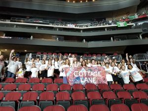 CLE Fifth-Grade Chorus with school banner in Prudential Center seats for AYV Concert