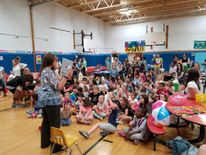 Local author reads to crowd of students, parents and staff in WOS gym