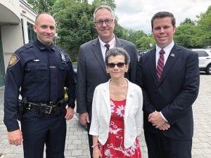SRO Andrew Vergine, Superintendent Robert Pritchard, Board President Rosemary Pitruzzella and Town Supervisor Chris Day posed photo