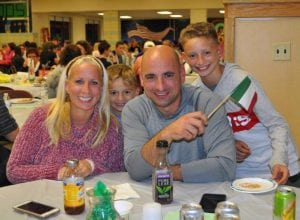 Woman, man and two children at Annual Italian Potluck Dinner