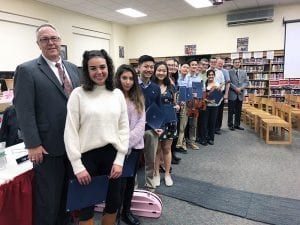 BOE, superintendent and music students stand for posed group photo