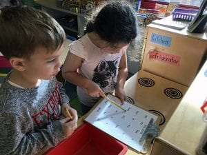 Kindergartners doing phonics scavenger hunt