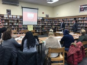Dr. Corey and Mr. Onativia presenting slideshow at SOMS PTA meeting