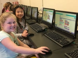 Students participating in Hour of Code at WOS