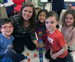 Material science engineer building maze with first-grade students