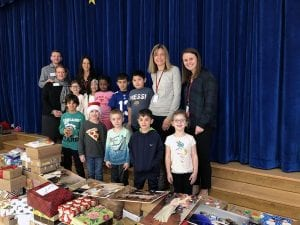 WOS students, teachers with Blizzard Box donations