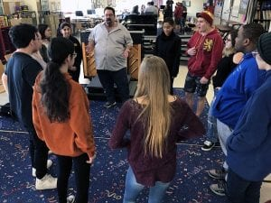 Actor Adam Sietz leaders students in a round of drama exercise