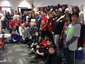 Mentors with Tappan Zee High School robotics team members in group pose