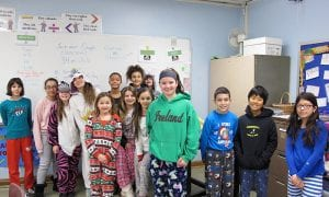 SOMS students standing in line, wearing pajamas