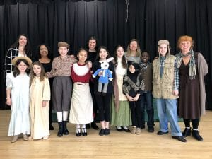 Student performers and teachers onstage at WOS