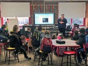 Principal speaks with students about bus safety