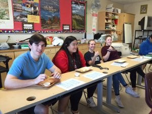 Students with cheese plates