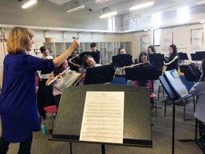 Master flutist conducting class of students